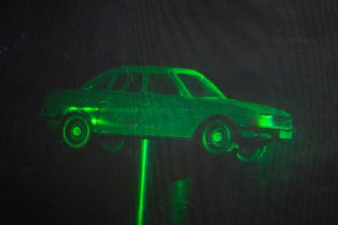 White light hologram of a car model