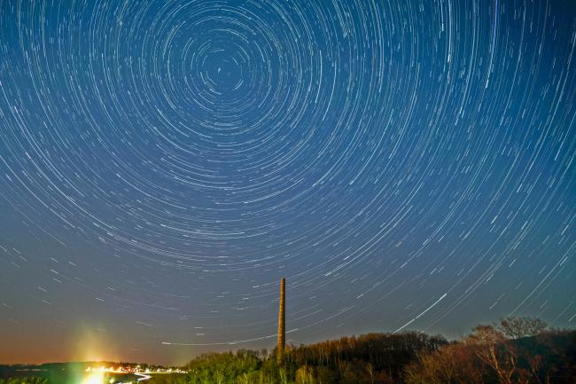 Startrails over an industrial chimney